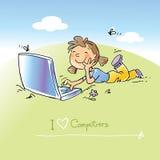 Niño con el ordenador portátil Fotos de archivo