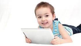Niño con el panel táctil Fotografía de archivo libre de regalías
