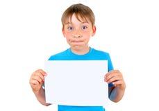 Niño con el papel en blanco Imagenes de archivo