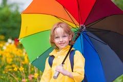 Niño con el paraguas Foto de archivo libre de regalías