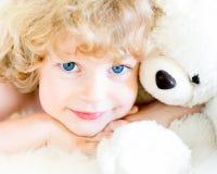 Niño con el peluche Fotografía de archivo