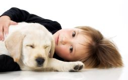 Niño con el perrito Fotografía de archivo