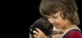 Niño con el perrito Imagen de archivo