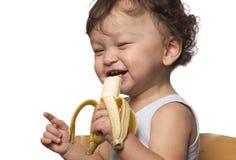 Niño con el plátano. Imagenes de archivo