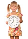 Niño con el reloj Imagenes de archivo