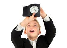 Niño con el reloj Imagen de archivo libre de regalías