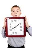 Niño con el reloj grande Fotografía de archivo libre de regalías
