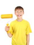 Niño con el rodillo de pintura Imágenes de archivo libres de regalías