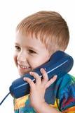 Niño con el teléfono Foto de archivo libre de regalías
