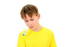 Niño con el termómetro Imagen de archivo
