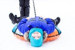 Niño con el tubo de la nieve Imagen de archivo