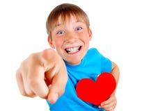 Niño con forma del corazón Fotografía de archivo