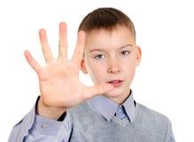 Niño con gesto de la palma Imagenes de archivo
