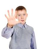Niño con gesto de mano de la parada Imagen de archivo libre de regalías