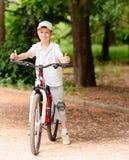 Niño con la bici Fotografía de archivo