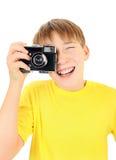 Niño con la cámara de la foto Imagen de archivo