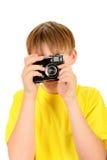 Niño con la cámara de la foto Fotografía de archivo