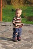 Niño con la cadena Foto de archivo libre de regalías