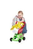 Niño con la carretilla de las compras Imagenes de archivo