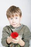 Niño con la flor Fotografía de archivo libre de regalías