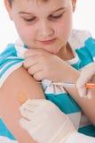 Niño con la inyección Fotografía de archivo libre de regalías