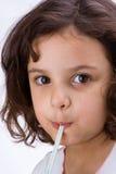 Niño con la paja Foto de archivo libre de regalías
