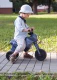 Niño con la primera bici Imagen de archivo libre de regalías