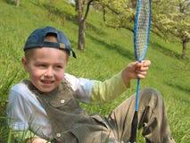 Niño con la raqueta de bádminton Imagen de archivo libre de regalías