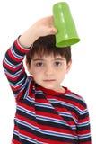 Niño con la taza vacía fotos de archivo libres de regalías