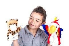 Niño con las marionetas de mano Imagenes de archivo