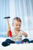 Niño con las monedas Fotografía de archivo libre de regalías