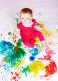 Niño con las pinturas Imágenes de archivo libres de regalías