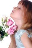 Niño con las rosas Imagen de archivo libre de regalías
