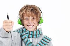 Niño con los auriculares Imagen de archivo libre de regalías
