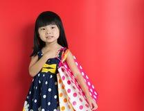 Niño con los bolsos de compras Fotografía de archivo