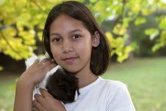 Niño con los conejillos de Indias Imagen de archivo libre de regalías