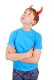 Niño con los cuernos del diablo Foto de archivo