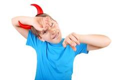 Niño con los cuernos del diablo Fotografía de archivo libre de regalías
