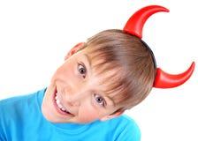 Niño con los cuernos del diablo Imagen de archivo
