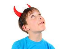 Niño con los cuernos del diablo Fotografía de archivo
