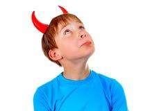 Niño con los cuernos del diablo Imágenes de archivo libres de regalías