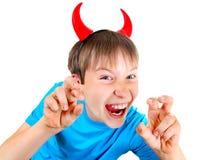 Niño con los cuernos del diablo Fotos de archivo libres de regalías