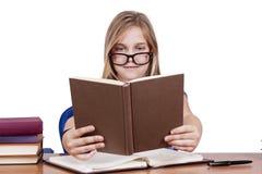 Niño con los libros Imagenes de archivo