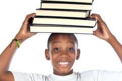 Niño con los libros en la pista Imágenes de archivo libres de regalías