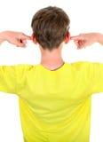 Niño con los oídos cerrados Imagen de archivo libre de regalías
