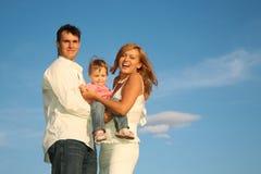 Niño con los padres Foto de archivo