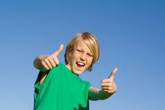 Niño con los pulgares para arriba Fotografía de archivo libre de regalías