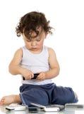 Niño con los teléfonos móviles. Fotos de archivo libres de regalías
