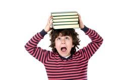 Niño con muchos libros Fotografía de archivo libre de regalías