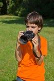 Niño con photocamera Fotografía de archivo
